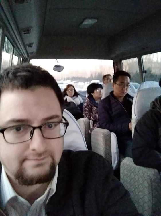 Taking the morning bus with other teachers.